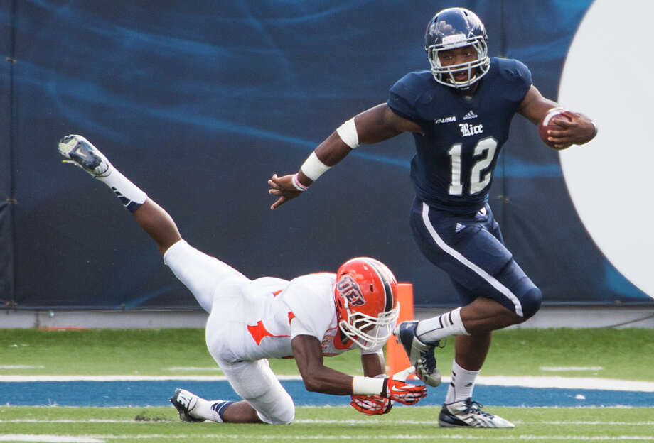 Charles Ross (1,013 yards) leads a Rice rushing attack that ranks 15th nationally. Photo: Smiley N. Pool, Staff / © 2013  Houston Chronicle