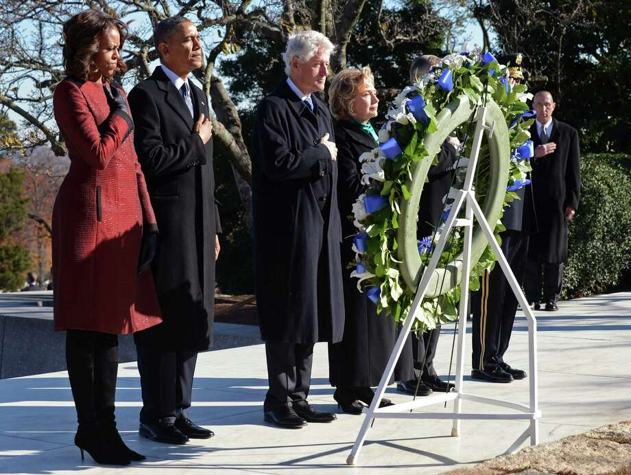 ARLINGTON, VA - NOVEMBER 20:  (L to R)  First lady Michelle Obama, U.S. President Barack Obama, Former U.S. President Bill Clinton and former U.S. Secretary of State Hillary Clinton lay a wreath at the grave site for President John F. Kennedy at Arlington National Cemetery November 20, 2013 in Arlington, Virginia. The 50th anniversary of the assassination of John F. Kennedy will be marked on November 22.  (Photo by Pat Benic-Pool/Gett Images) ORG XMIT: 451422415 Photo: Pool / 2013 Getty Images