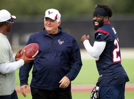 Defensive coordinator Wade Phillips, center, and Ed Reed, right, were laughing it up with defensive backs coach Vance Joseph at a practice in September, but it's doubtful they would be so jovial around one another today.
