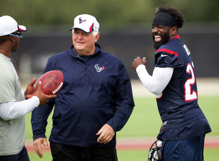 Defensive coordinator Wade Phillips, center, and Ed Reed, right, were laughing it up with defensive backs coach Vance Joseph at a practice in September, but it's doubtful they would be so jovial around one another today. Photo: Brett Coomer, Staff / © 2013  Houston Chronicle