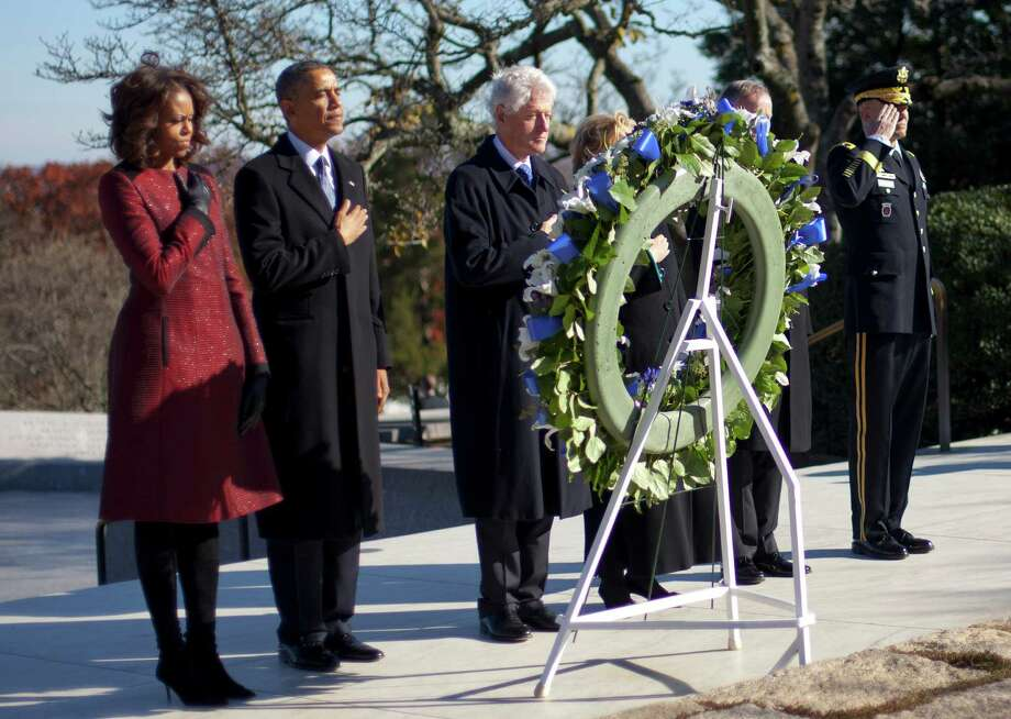 President Barack Obama, Michelle Obama, former President Bill Clinton and former Secretary of State Hillary Rodham Clinton, honor John F. Kennedy. Photo: Pablo Martinez Monsivais, STF / AP