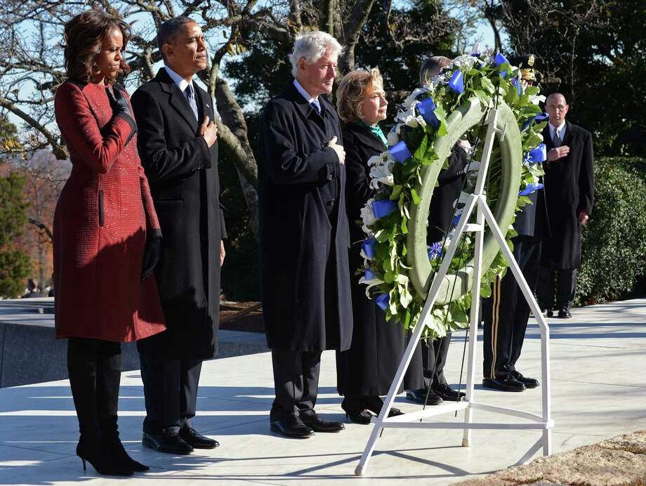 First lady Michelle Obama, President Barack Obama, former President Bill Clinton and former Secretary of State Hillary Clinton place a wreath at the grave of President John F. Kennedy. Photo: Pat Benic / Getty Images