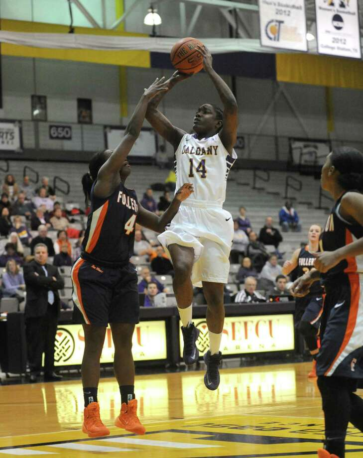 UAlbany's Tammy Phillip goes in for a score during their womens college basketball game against Cal-State Fullerton on Wednesday Nov. 20, 2013 in Albany, N.Y. (Michael P. Farrell/Times Union) Photo: Michael P. Farrell / 00024709A