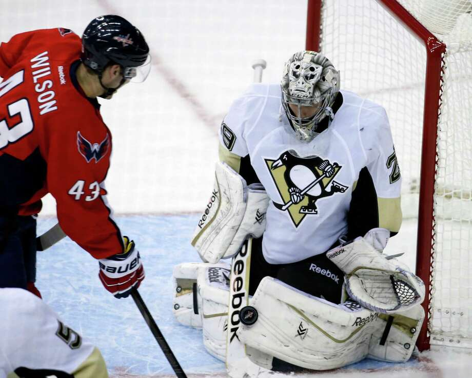 Pittsburgh Penguins goalie Marc-Andre Fleury (29) stops a shot by Washington Capitals right wing Tom Wilson (43) in the third period of an NHL hockey game, Wednesday, Nov. 20, 2013, in Washington. The Penguins won 4-0. (AP Photo/Alex Brandon) ORG XMIT: VZN108 Photo: Alex Brandon / AP
