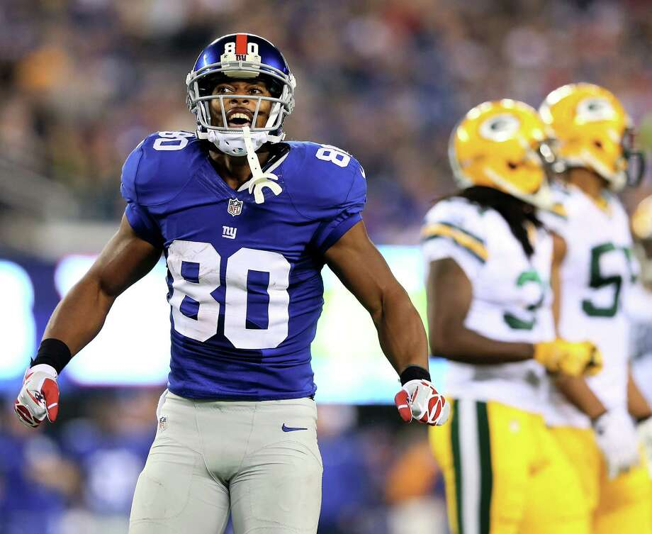 """Wide receiver Victor Cruz, who has 58 catches for 824 yards and four touchdowns for the surging Giants, said he is ready for """"another classic battle"""" with Cowboys cornerback Orlando Scandrick on Sunday. Photo: Elsa / Getty Images"""