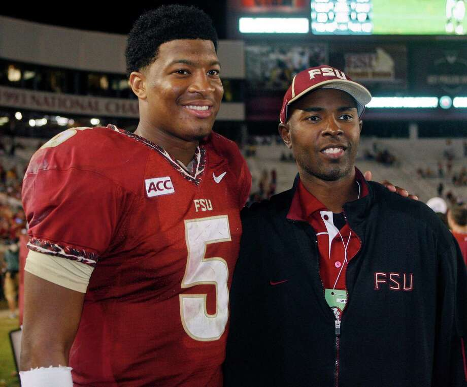 Florida State quarterback Jameis Winston (5) poses with former Florida State quarterback and Heisman Trophy winner Charlie Ward after an NCAA college football game against Syracuse on Saturday, Nov. 16, 2013, in Tallahassee, Fla. Florida State best Syracuse 59-3. (AP Photo/Phil Sears) Photo: Phil Sears, FRE / FR170567 AP