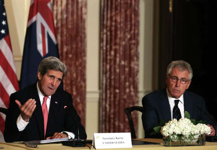 Secretary of State John Kerry (left) speaks on Afghanistan as Defense Secretary Chuck Hagel listens. Kerry said the U.S. finalized a security deal to keep troops in Afghanistan through 2024. Photo: Mark Wilson / Getty Images