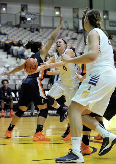 UAlbany's Sarah Royals drives in for a score during their womens college basketball game against Cal
