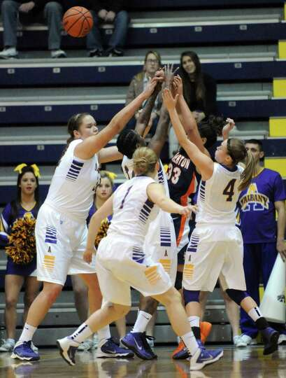 Cal-State Fullerton's Kathleen Iwuoha is swarmed by UAlbany defenders during their womens college ba