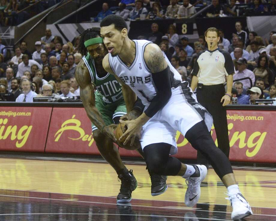 Danny Green of the Spurs and Gerald Wallace of the Celtics fight for the ball during second-half NBA action at the AT&T Center on Wednesday, November 20, 2013. The Spurs won, 104-93. Photo: San Antonio Express-News