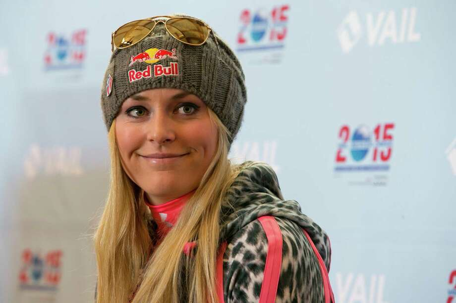 FILE - In this Nov. 8, 2013 file photo, Lindsey Vonn speaks at a press conference at Gold Peak, Vail, Colo. Reigning Olympic downhill champion Vonn has crashed while training ahead of her return to racing following major knee surgery. U.S. Ski Team spokesman Tom Kelly says Tuesday, Nov. 19, 2013,  that Vonn is being evaluated at a hospital after being taken off the slope at Copper Mountain, Colo., on a sled.  (AP Photo/Nathan Bilow, File) Photo: Nathan Bilow, FRE / FR37383 AP