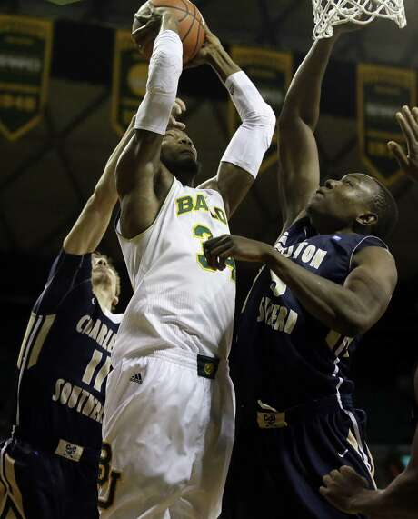 Baylor center Cory Jefferson, going up for a contested shot against Charleston Southern defenders, recorded 16 points and 11 boards in Waco. Photo: Tony Gutierrez / Associated Press