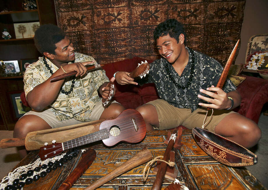 Warren's Trey Lealaimatafao (left) and Brennan's Grant Watanabe, both of Polynesian descent, are close friends. Photo: Tom Reel / San Antonio Express-News