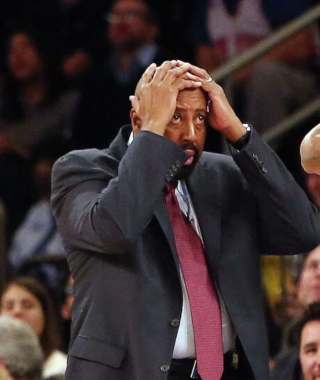 Knicks coach Mike Woodson is in disbelief after a foul gave the Pacers three free throws with 5.9 seconds left in regulation, points they needed to force OT. Photo: Bruce Bennett / Getty Images