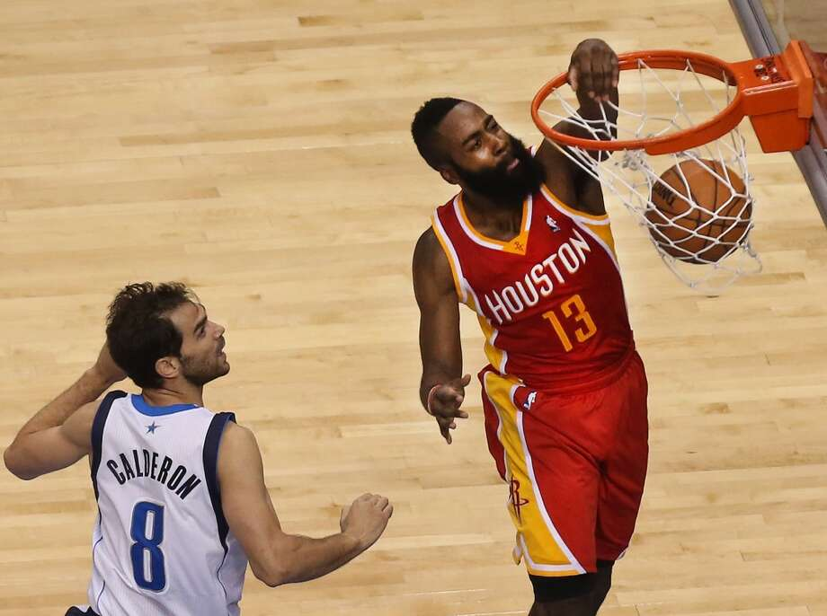 James Harden (13) dunks as Jose Calderon (8) watches. Photo: Louis DeLuca, Staff Photographer