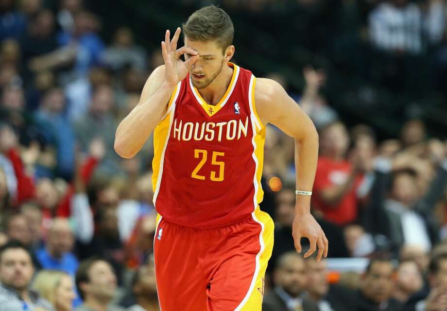 Chandler Parsons #25 of the Rockets celebrates a three-point shot. Photo: Ronald Martinez, Getty Images