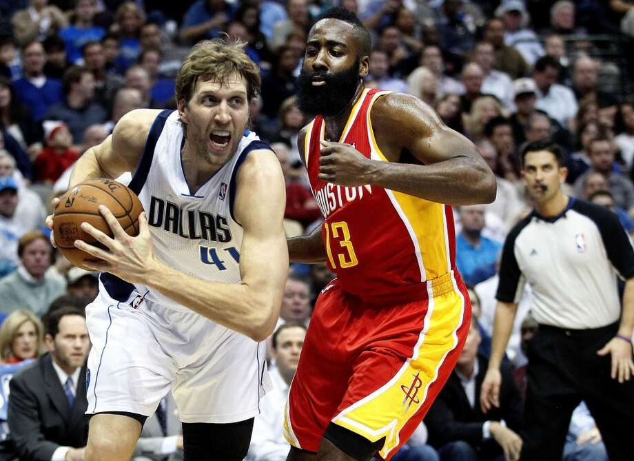 Mavericks power forward Dirk Nowitzki (41) drives past Rockets shooting guard James Harden (13). Photo: Ron Jenkins, McClatchy-Tribune News Service