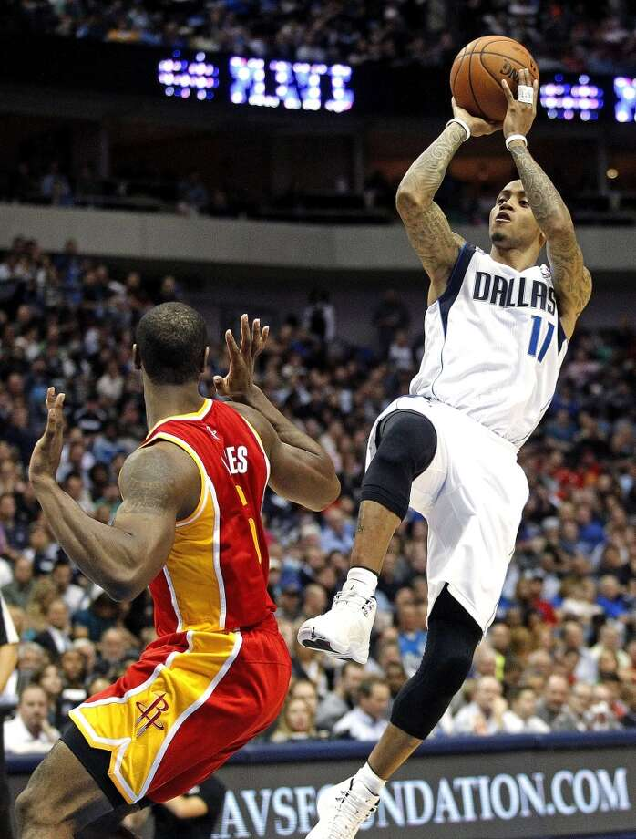 Mavericks shooting guard Monta Ellis (11) shoots over Rockets power forward Terrence Jones (6). Photo: Ron Jenkins, McClatchy-Tribune News Service