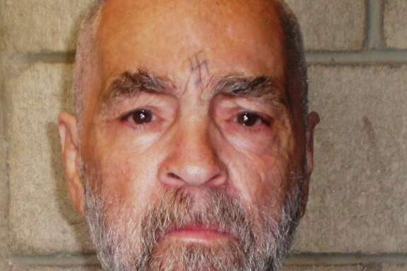 In March 18, 2009 handout photo of cult killer Charles Manson  who has been one of the thousands of prison inmates who have used unauthorized cell phones to make calls around the nation.