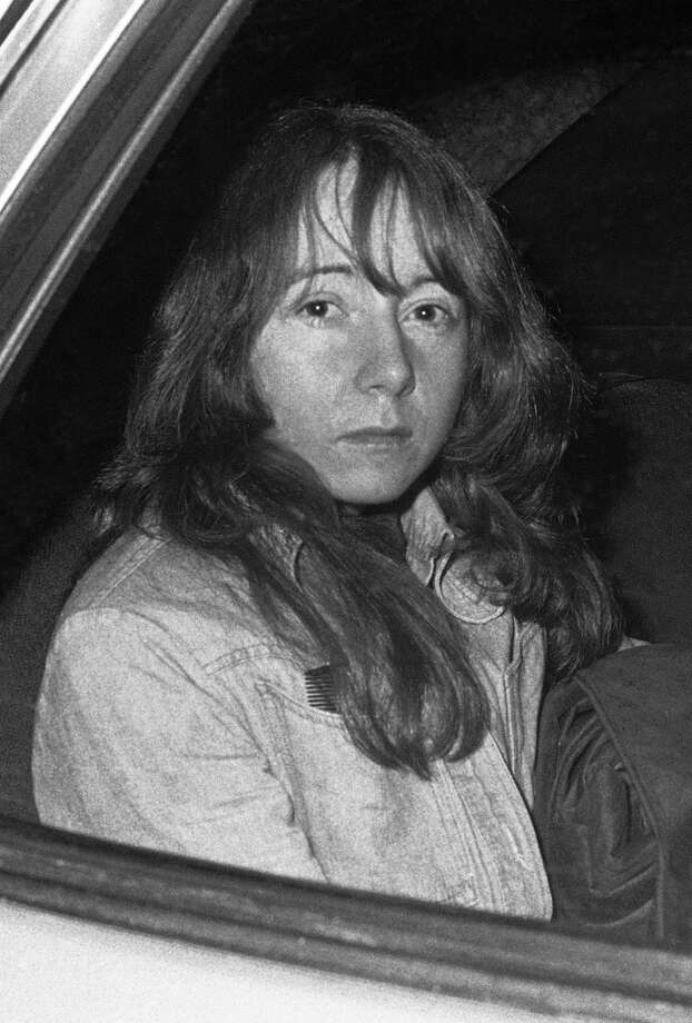 In this Nov. 25, 1975 file photo, Manson Family member Lynette 'Squeaky' Fromme sits in a U.S. Marshall's vehicle in Sacramento. Fromme was not present at either the Tate or LaBianca killings and continued to follow Manson after his conviction. In 1975, Fromme was arrested for attempting to assassinate President Gerald Ford in Sacramento. She was paroled in 2009. Photo: Walt Zeboski, AP
