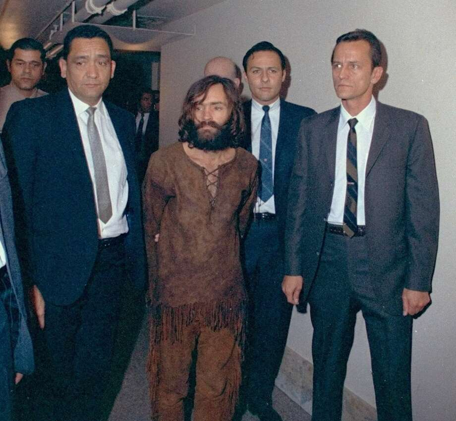 Charles Manson is escorted to Los Angeles Court on December 11, 1969 for arraignment on conspiracy charges in connection with the slayings of actress Sharon Tate and seven others. Photo: FILE, Associated Press