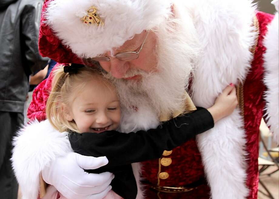 "All she wants for Christmas is her two front teeth: Madelyn Bertrand hugs Santa Claus during the ""Home 