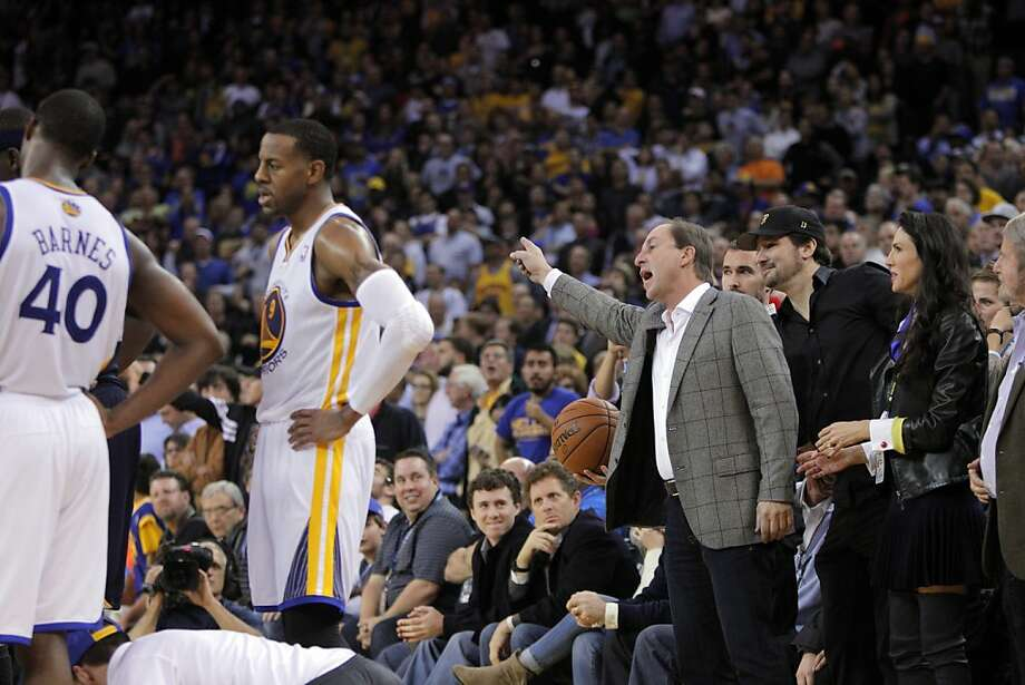 Warriors owner Joe Lacob gestures to the referees that the ball should be awarded to the Warriors after an out-of-bounds was reviewed in the second half. The Golden State Warriors played the Memphis Grizzlies at Oracle Arena in Oakland, Calif., on Wednesday, November 20, 2013. The Grizzlies won 88-81 in overtime. Photo: Carlos Avila Gonzalez, The Chronicle