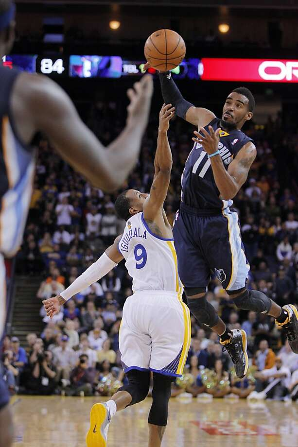Andre Iguodala started at point guard with Stephen Curry out and volunteered to guard Memphis' Mike Conley (11). Photo: Carlos Avila Gonzalez, The Chronicle