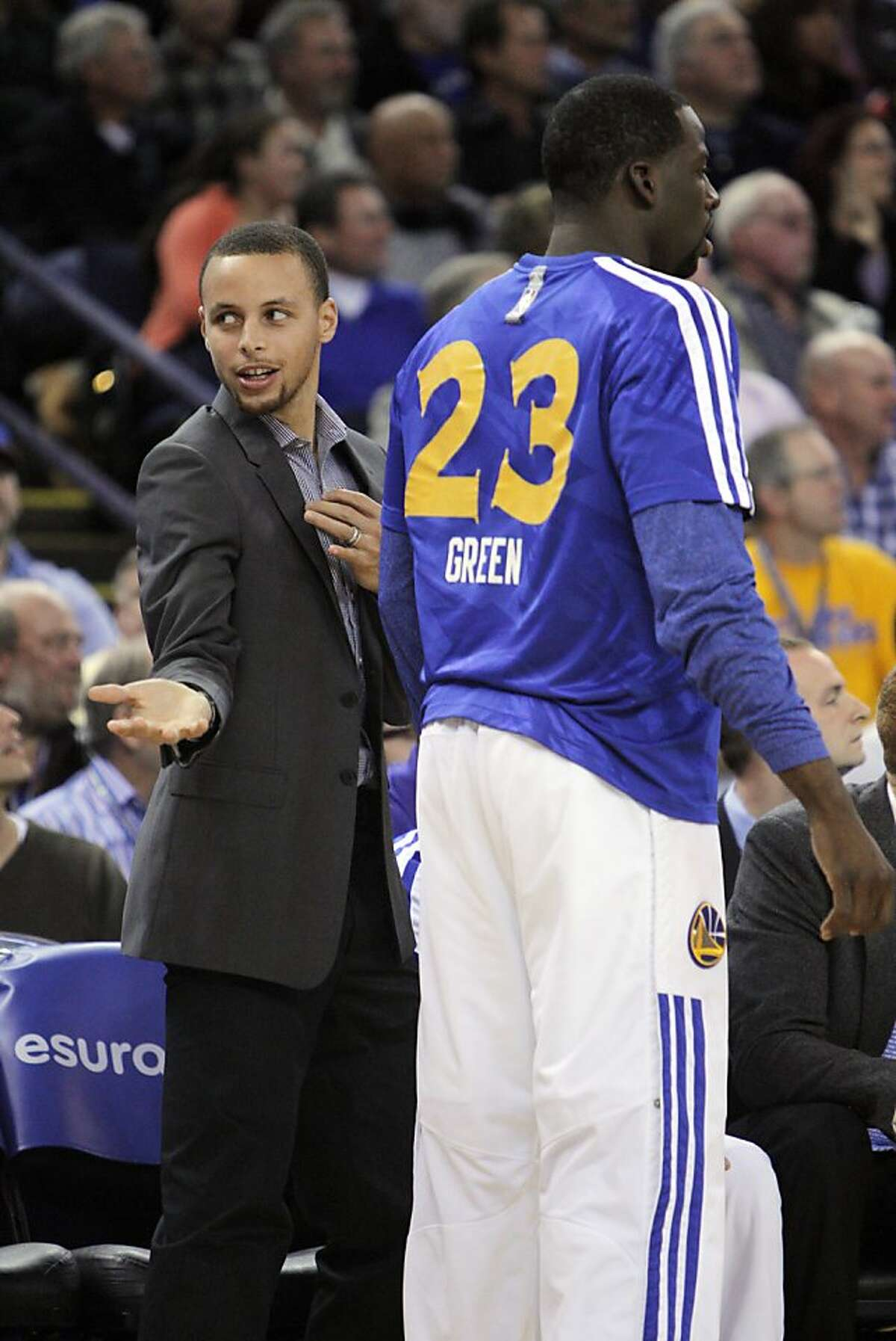 Stephen Curry gestures on the bench after Klay Thompson hit a three-point shot in the first half. The Golden State Warriors played the Memphis Grizzlies at Oracle Arena in Oakland, Calif., on Wednesday, November 20, 2013