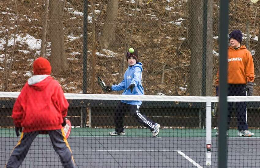 Tommy Kelley, 12 of Fairfield, eyes the ball as young players compete in the 2010 Junior National Platform Tennis Championships hosted by the New Canaan Field Club in New Canaan, Conn. on Saturday, Jan. 30, 2010.