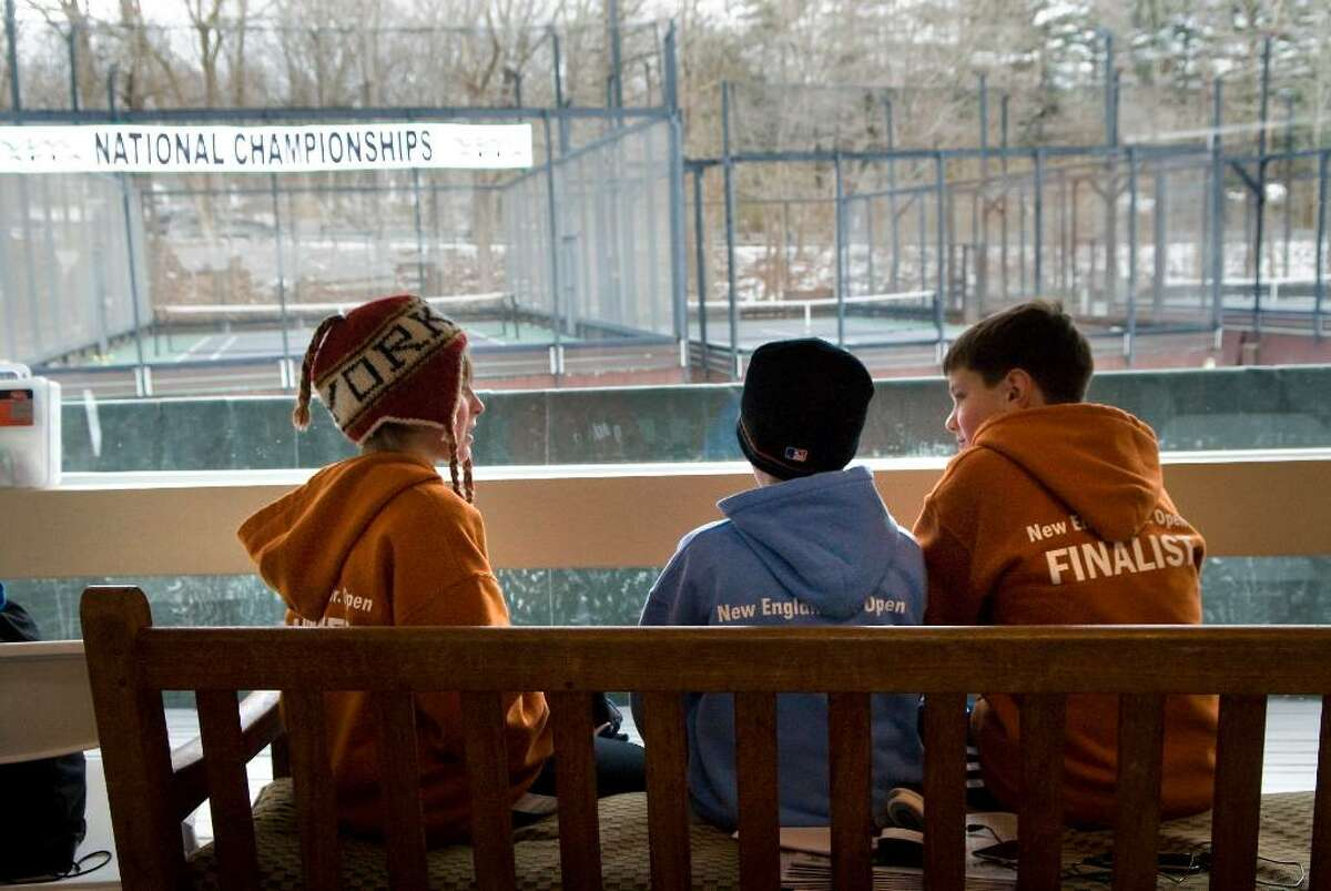 Young players stay warm inside in between matches at the 2010 Junior National Platform Tennis Championships hosted by the New Canaan Field Club in New Canaan, Conn. on Saturday, Jan. 30, 2010.