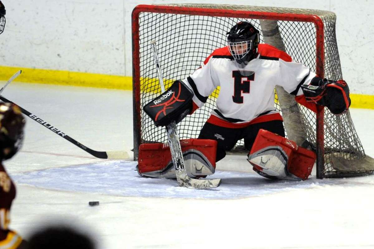 Fairfield's goalie Patrick Cooney eyes a puck to block, during game action against St. Joseph at the Wonderland of Ice rink in Bridgeport, Conn. on Saturday Jan. 30, 2010.