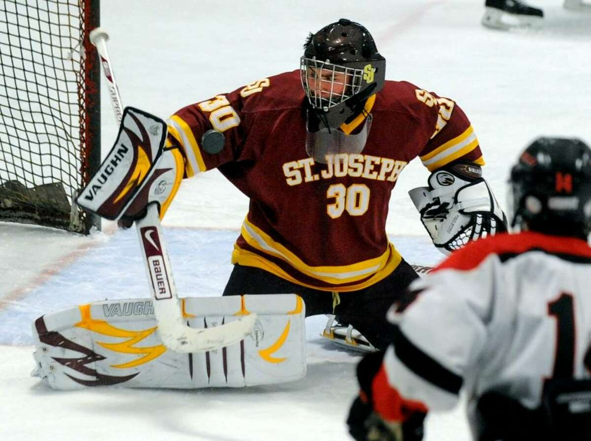 St. Joseph's goalie Zack Carrano deflects a Fairfield goal attempt, during game action at the Wonderland of Ice rink in Bridgeport, Conn. on Saturday Jan. 30, 2010.