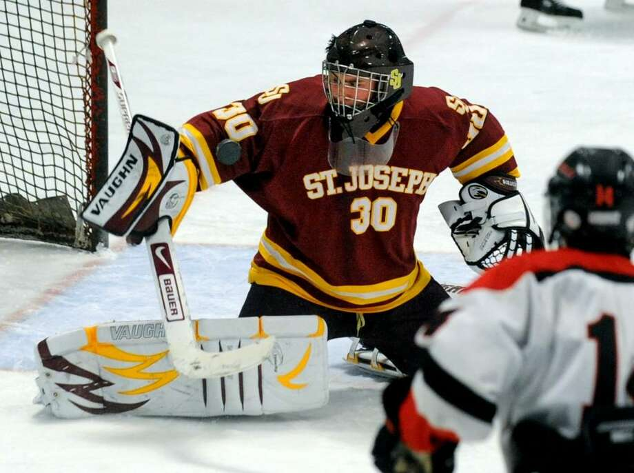 St. Joseph's goalie Zack Carrano deflects a Fairfield goal attempt, during game action at the Wonderland of Ice rink in Bridgeport, Conn. on Saturday Jan. 30, 2010. Photo: Christian Abraham / Connecticut Post