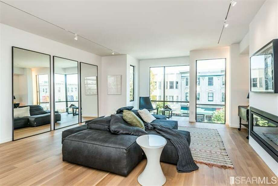Swank living room.  Photos via MLS/Frank Nolan, Vanguard Properties