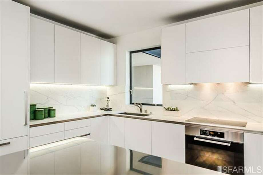 Very white kitchen, one hopes self-cleaning.  Photos via MLS/Frank Nolan, Vanguard Properties