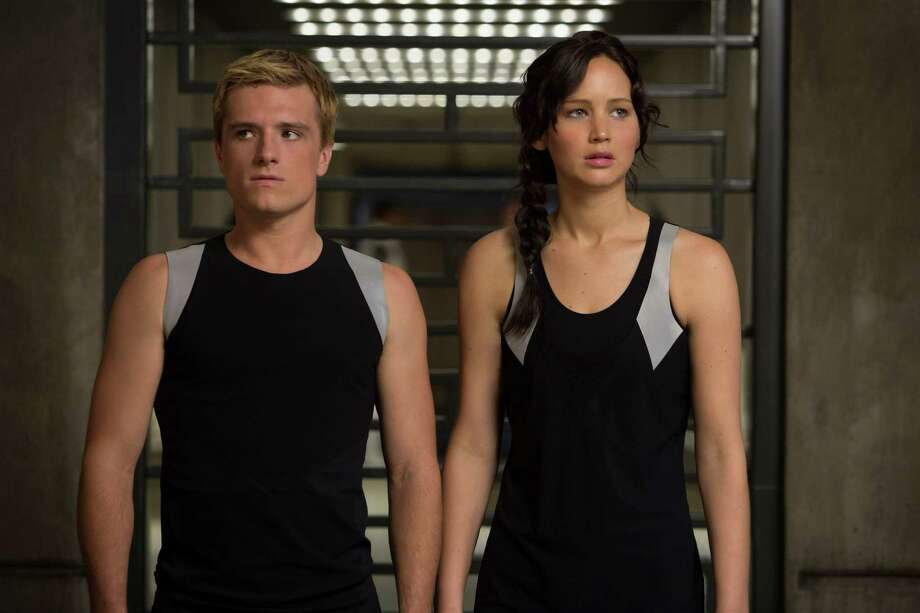 "This image released by Lionsgate shows Josh Hutcherson as Peeta Mellark, left, and Jennifer Lawrence as Katniss Everdeen in a scene from ""The Hunger Games: Catching Fire."" (AP Photo/Lionsgate, Murray Close) ORG XMIT: NYET539 Photo: Murray Close / Lionsgate"