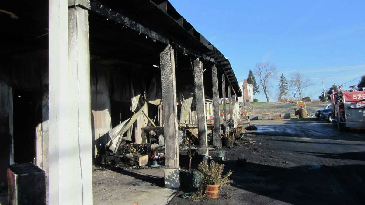 The Love Apple Farm in Ghent is shown on Thursday, Nov. 21, 2013, a day after fire struck. (Bob Gardinier)