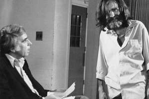 This June 1981 file photo shows talk show host Tom Snyder,left, getting ready to interview convicted murderer Charles Manson at the California Medical Facility in Vaccaville.  Snyder died Sunday, July 29, 2007, in San Francisco from complications associated with leukemia.