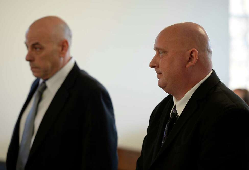 Albany Police officer Brian Lutz stands in Menands Town Court after receiving his sentence from Judge Lisa Anne Proskin Thursday morning Nov. 21, 2013 in Menands, N.Y. (Skip Dickstein/Times Union)