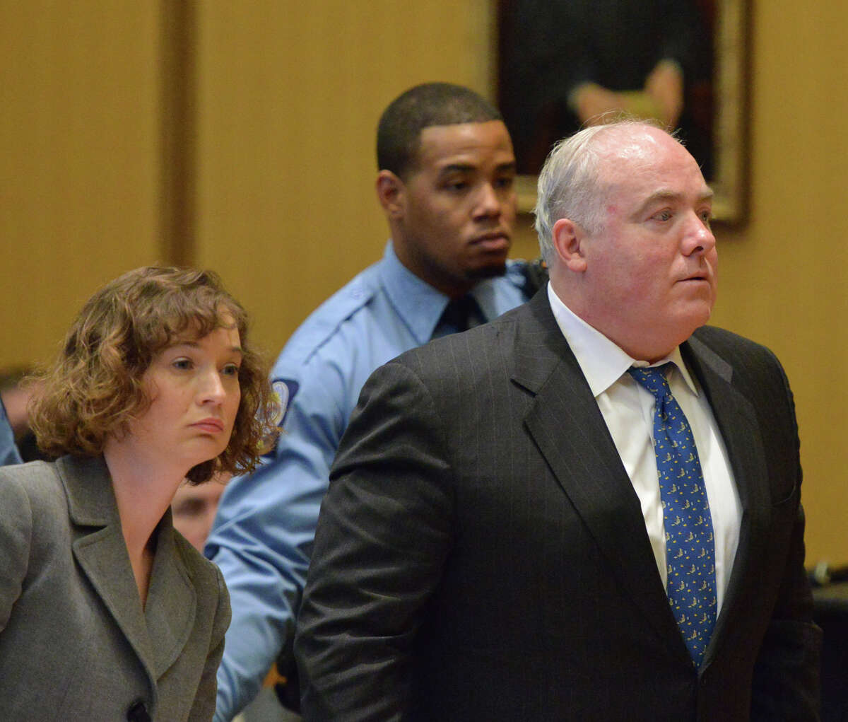 Michael Skakel reacts to being granted bail during his hearing at Stamford Superior Court, in Stamford, Conn., Thursday, Nov. 21, 2013. At left is one of Skakel's attorney's Jessica Santos. Skakel will be released on bail after receiving a new trial for the 1975 murder of his Greenwich, Conn., neighbor, Martha Moxley, which he was convicted of in 2002.