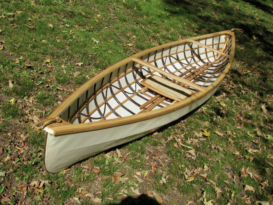 This handcrafted 20-pound canoe will be among the items offered in an auction Sunday, Nov. 24, in Washington, Conn., to benefit The Housatonic Valley Association, which serves the Housatonic River Valley from north of Pittsfield to Long Island Sound. Photo: Contributed Photo / The News-Times Contributed
