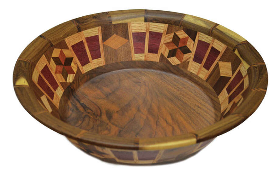 Wooden Salad Bowl Looking to add style to your tabletop? Each bowl created by Winchester Woodworks is designed to be both functional and beautiful, incorporating a variety of rich wood species into a segmented, precision-cut pattern. Hand-made by a woodworking artisan based in North Carolina, the bowls come in a large range of designs and sizes. This one is $248 at Pearl Grant Richmans.