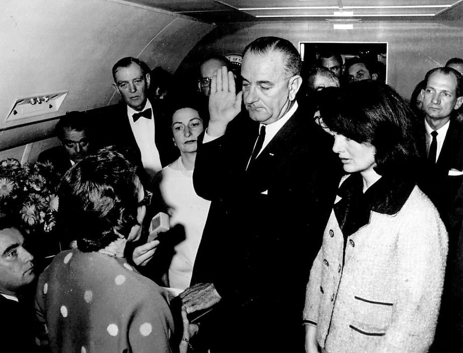 """2:38 p.m., November 22, 1963: President Lydon Johnson is sworn in aboard Air Force One as Kennedy's body is transported on the same plane back to Washington, D.C.""""I am a retired Delta Airline pilot, and I was on my trip from Hobby to New York. I was about halfway to New York when the controller told me I could not change altitude because Air Force One would be passing under me southbound. I saw him coming and I asked the pilot how they were doing. He said, """"OK, just fine."""" I asked him how his """"first-class passenger"""" was, and he said, """"Just fine, looking forward to going to Texas.""""  The next day, I was flying back to New York. When I was taxiing to the runway, I was told JFK was shot. We were about halfway, when Air Force One came on the radio, saying they were going to Washington. It was the same pilot, and he could hardly talk.""""Jim Shannon, Houston  Photo: Cecil Stoughton, Associated Press"""
