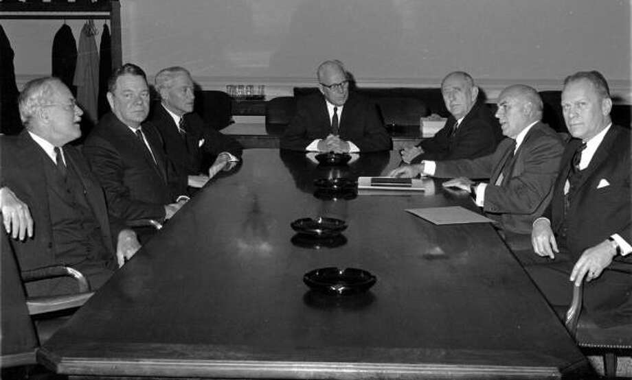 "December 5, 1963: The Warren Commission, the group investigating the assassination of President John F. Kennedy, meets for the first time. Among the group is Rep. Hale Boggs (D-La.), second from left, who presumably died in 1972, when a twin-engine plane disappeared in a remote part of Alaska. The wreckage was never found. Congressman Nick Begich also was aboard and presumed dead. Boggs was not declared until Jan. 3, 1973.""I was eight years old on Nov. 22, 1963, living on a remote Air Force Base in Clear, Alaska, when my teacher told me the news that our president had been killed in Dallas that day (we were 4 hours behind in our time zone). My father was in charge of maintaining the Ballistic Missile Early Warning System (BMEWS) and the danger of incoming missiles from Russia was a very real concern in those days. My school was on the base and I was immediately taken home, where my mother and father were crying and listening to the radio. There was no TV. It was the first time I ever saw my father cry, but I was mostly worried about what the Russians might do to us, now that our President was dead. It was the end of my childhood innocence and the awareness that violence was a real threat to anyone at anytime.  A sad reality to learn at such a young age.""Vicki Finch of Pearland Photo: AP File"