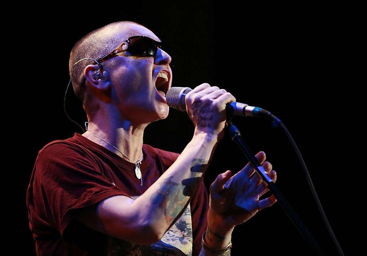 In this photo taken Tuesday, Nov. 12, 2013, Sinead O'Connor performs at the Riviera Theatre in North Tonawanda, N.Y. (AP Photo/The Buffalo News, Harry Scull Jr.) TV OUT; MAGS OUT; MANDATORY CREDIT; BATAVIA DAILY NEWS OUT; DUNKIRK OBSERVER OUT; JAMESTOWN POST-JOURNAL OUT; LOCKPORT UNION-SUN JOURNAL OUT; NIAGARA GAZETTE OUT; OLEAN TIMES-HERALD OUT; SALAMANCA PRESS OUT; TONAWANDA NEWS OUT