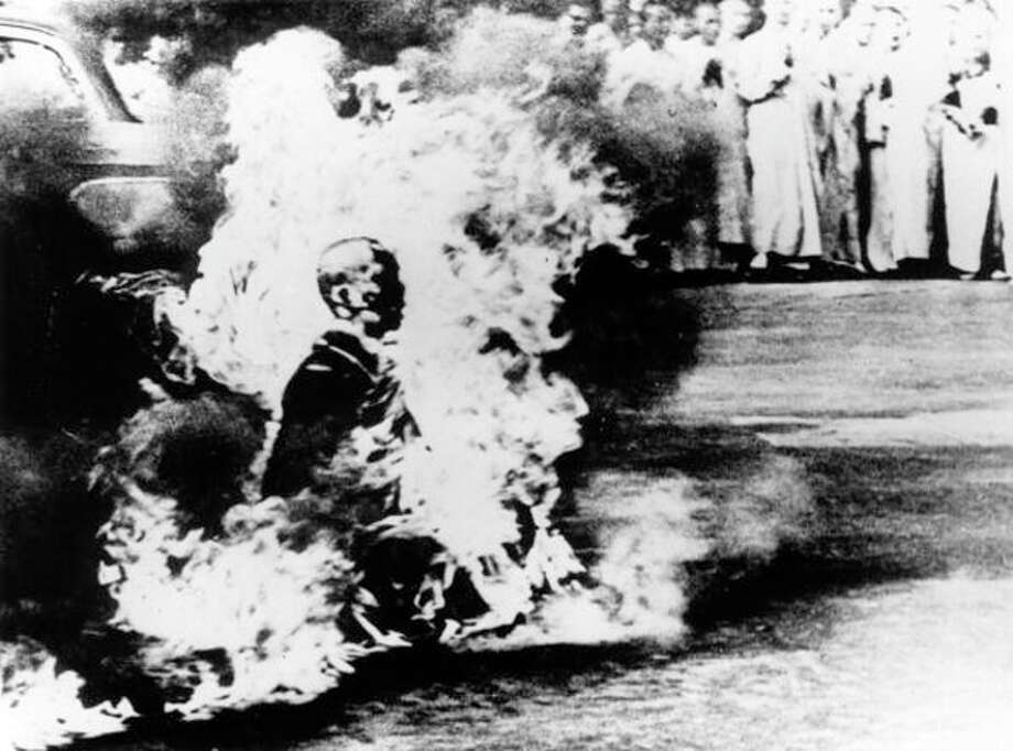 A buddhist monk makes the ultimate protest in Saigon by setting himself alight.  (Photo by Keystone/Getty Images) Photo: Keystone, Getty Images / Hulton Archive
