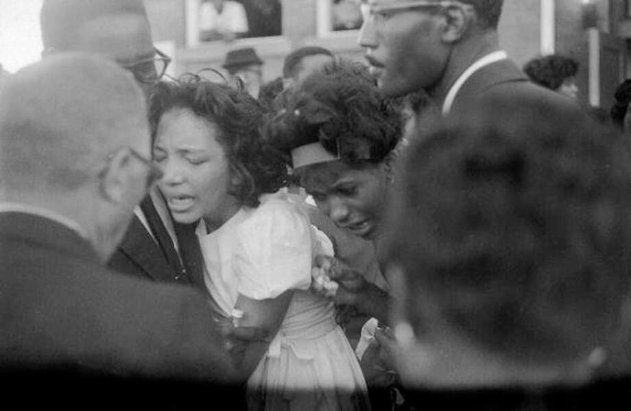 Four are killed and 22 wounded in the 16th Street Baptist Church bombing in Birmingham, Ala. Photo: Burton McNeely, Time & Life Pictures/Getty Image / Burton Mcneely