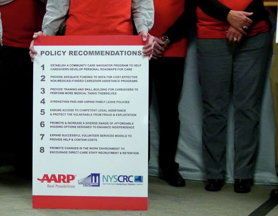 An AARP member holds a large board with policy recommendations on it during a press conference held by AARP at the Legislative Office Building on Thursday, Nov. 21, 2013 in Albany, NY.  The press event was held for AARP to release a legislative blueprint for improving New Yorka€™s approach to supporting the 4.1 million unpaid family caregivers.   (Paul Buckowski / Times Union) Photo: Paul Buckowski / 00024739A