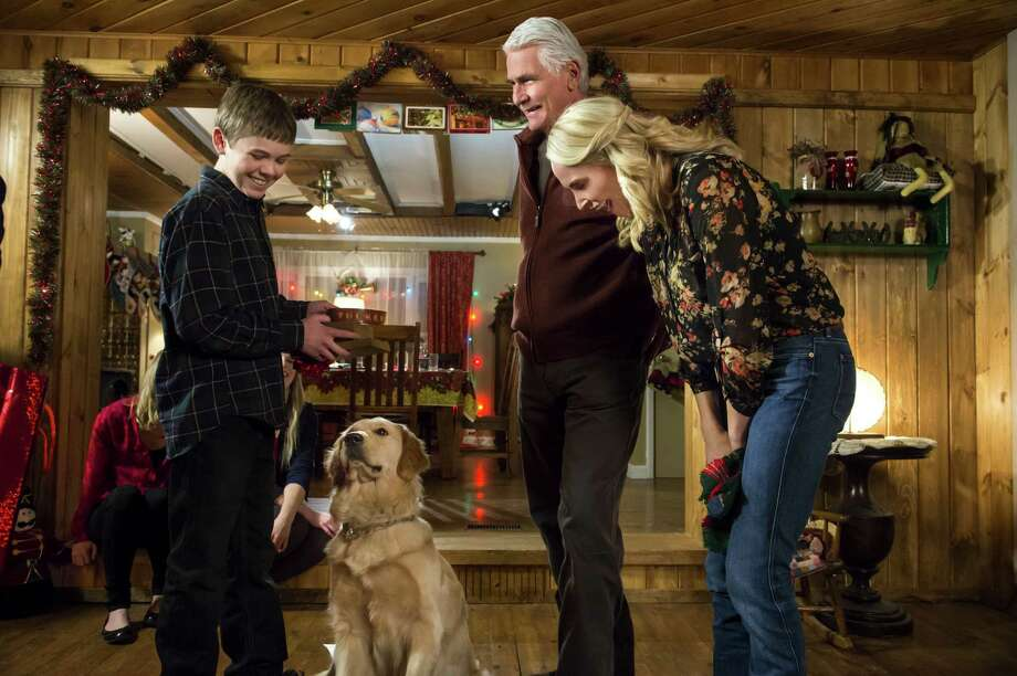 "A boy, grieving for his father and away from his mom, bonds with a dog in the Hallmark tear-jerker ""Christmas With Tucker."" Gage Munroe plays the boy, James Brolin plays the boy's grandfather, and Josie Bissett is his mom. Photo: Hallmark Channel"